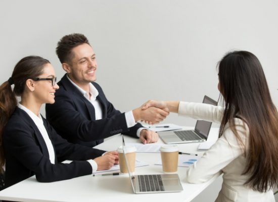 friendly-partners-handshaking-group-meeting-thanking-successful-teamwork_1163-4691